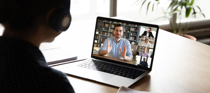 A student watching a webinar with five people on screen.